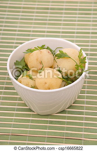 Boiled potatoes with parsley on a bamboo - csp16665822