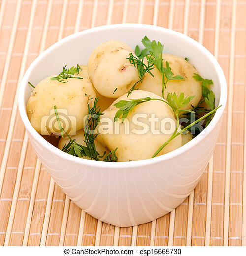 Boiled potatoes with parsley on a bamboo - csp16665730