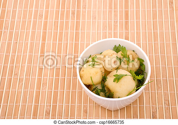 Boiled potatoes with parsley on a bamboo - csp16665735