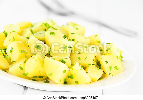 Boiled Potatoes with Parsley - csp63054671