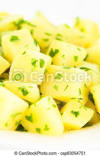 Boiled Potatoes with Parsley - csp63054751