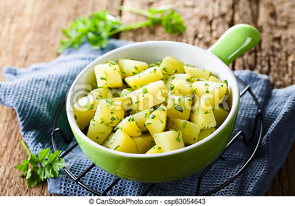 Boiled Potatoes with Parsley - csp63054643