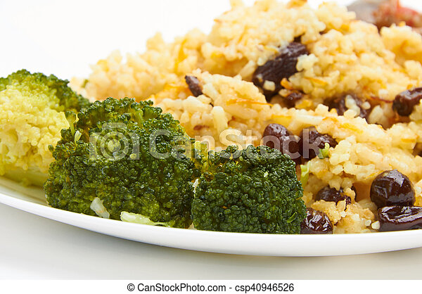 boiled rice with raisins on white plate - csp40946526