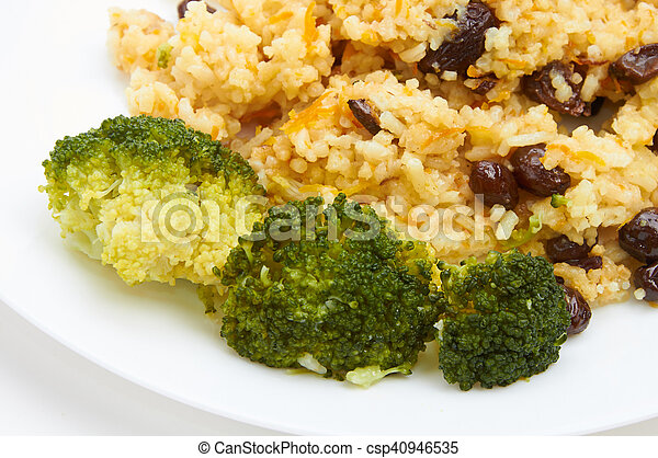 boiled rice with raisins on white plate - csp40946535