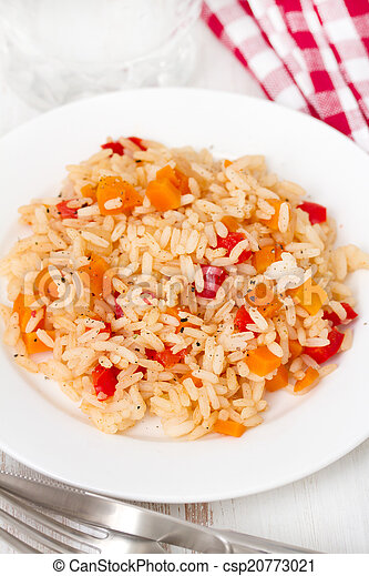 boiled rice with vegetables on plate - csp20773021