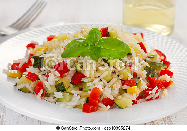 boiled rice with vegetables on the white plate - csp10335274