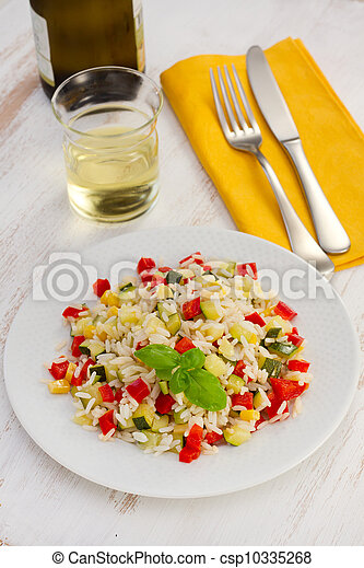 boiled rice with vegetables on the white plate - csp10335268