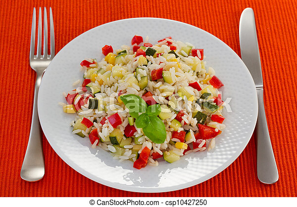 boiled rice with vegetables on the white plate - csp10427250