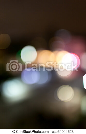 Bokeh at night in the city as a background - csp54944623