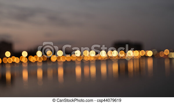 Bokeh night lights blurry abstract backgroun og city waterfront in a night - csp44079619