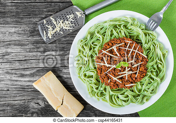 Bolognese ragout with green  pasta tagliatelle, top view - csp44165431