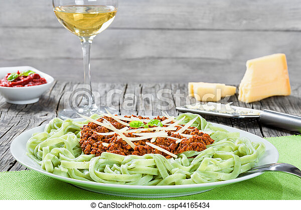 Bolognese ragout with green  pasta tagliatelle, top view - csp44165434