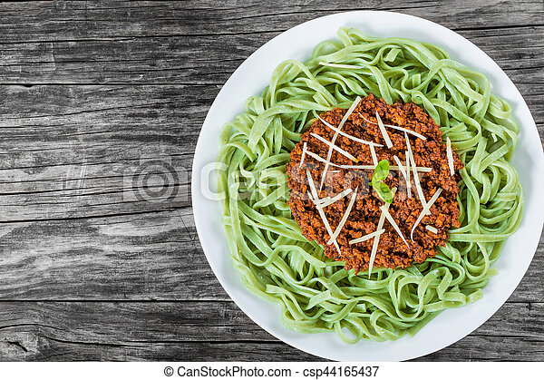 Bolognese ragout with green  pasta tagliatelle, top view - csp44165437