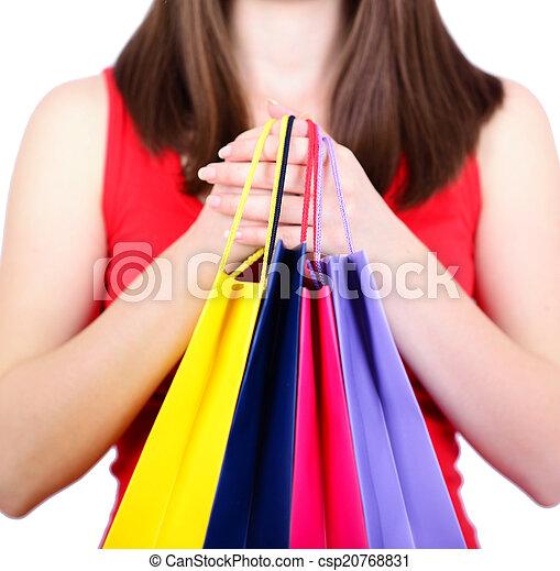 Mujer sosteniendo bolsas de compras - csp20768831