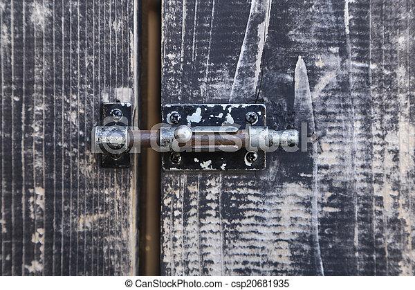 Bolt on old wooden door - csp20681935