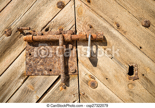 Bolted door - csp27322079 & Bolted door. Full frame take of an old door with a rusty... picture ...