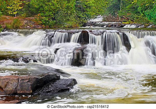 Bond Falls Waterfall in Michigan - csp21516412