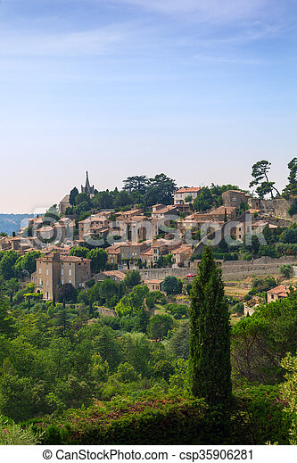 Bonnieux charming old small village and church the Provence region - csp35906281