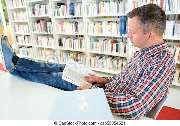book collector reading - csp53054521