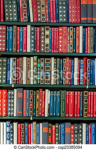 books in a library - csp23385094