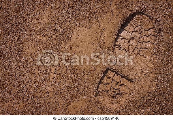 Bootprint on mud  - csp4589146