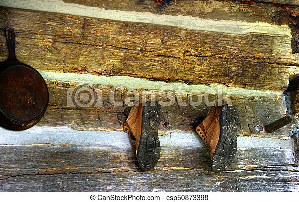 Boots Hanging on Cabin - csp50873398