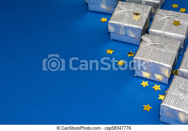 border of silver shiny gifts and golden stars on blue background csp58347776