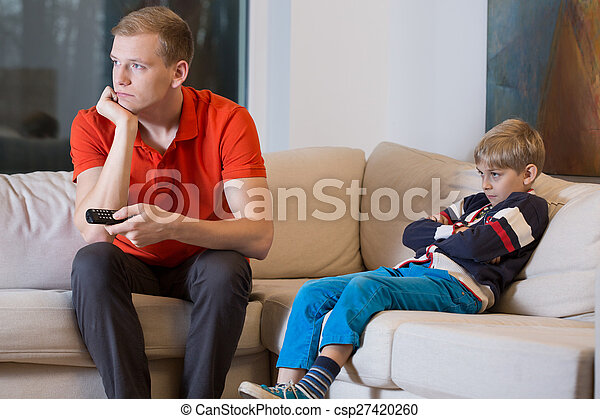 Bored child and father is watching TV - csp27420260
