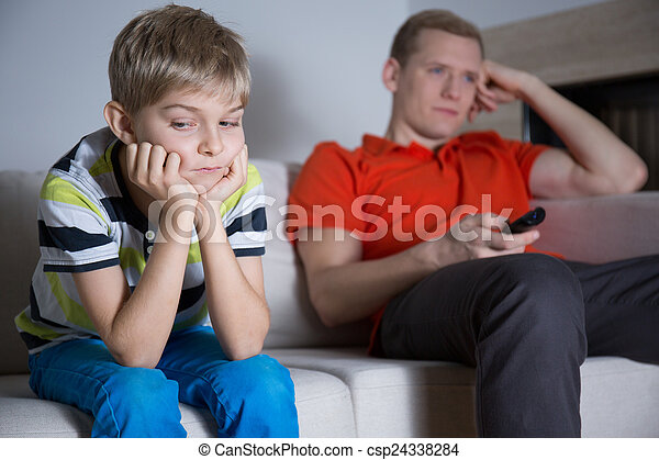 Bored child sitting on the sofa - csp24338284