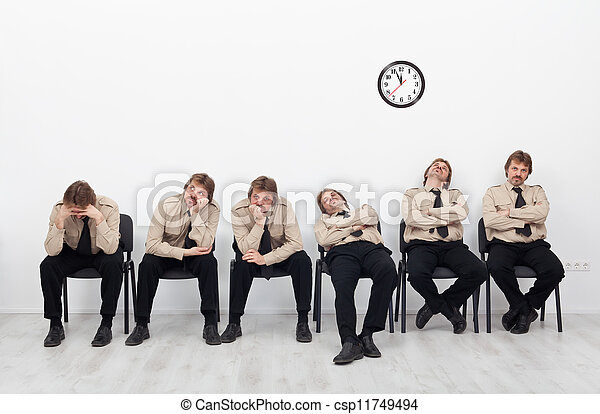 Bored people waiting - csp11749494