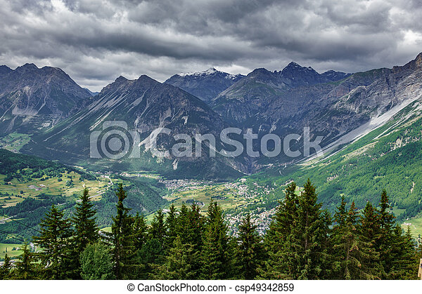 Bormio city and Dolomites top view, stormy clouds - csp49342859