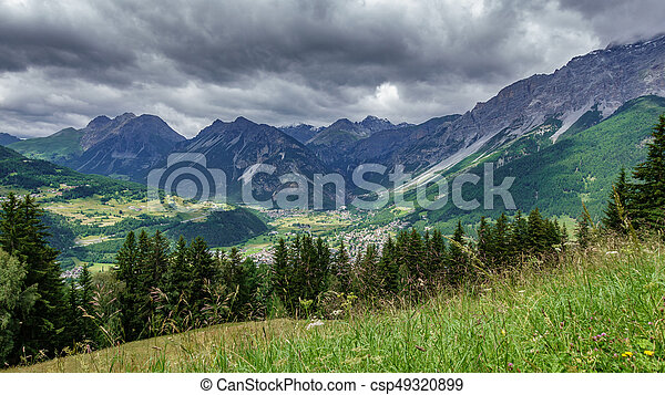 Bormio city and Dolomites top view, stormy clouds - csp49320899