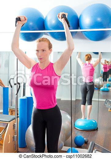 Bosu ball for fitness woman in aerobics gym - csp11002682