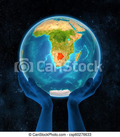 Botswana on Earth in hands - csp60276633