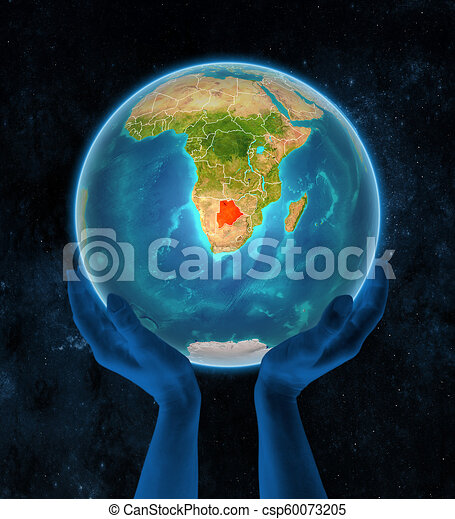 Botswana on Earth in hands in space - csp60073205