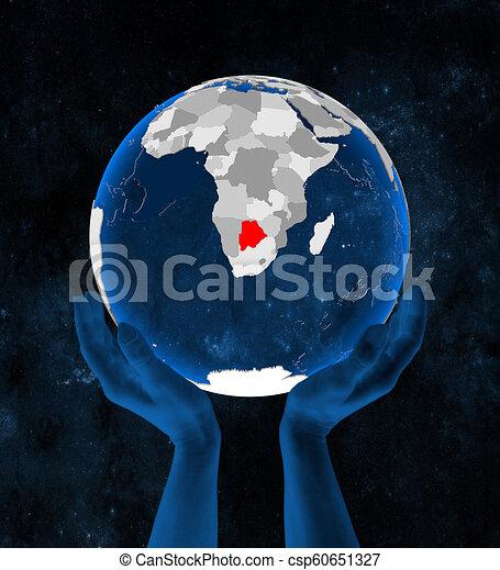 Botswana on globe in hands - csp60651327
