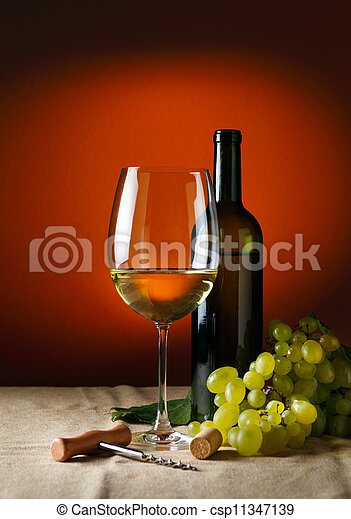 Bottle and glass of red wine - csp11347139