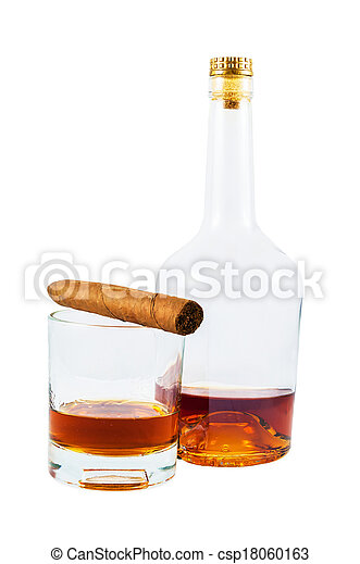 Bottle and glass of whiskey with cigar - csp18060163
