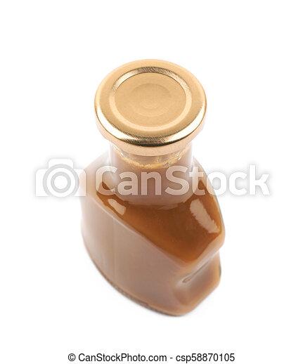 Bottle of caramel sauce isolated - csp58870105