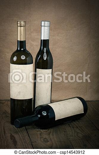 bottle of vine on wooden background - csp14543912