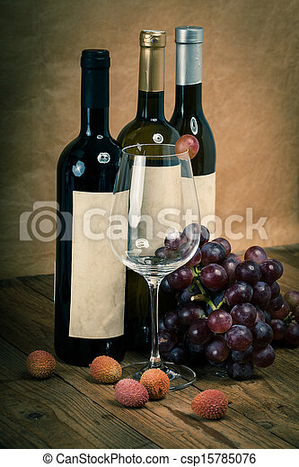 bottle of vine with wine glass and grapes, on wooden background - csp15785076