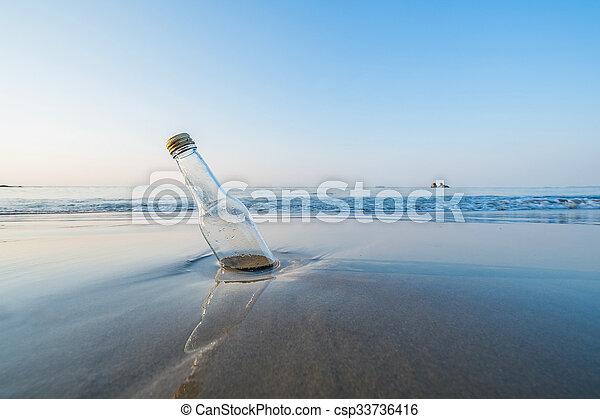 Bottle on the beach - csp33736416