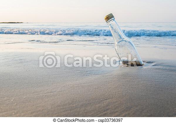 Bottle on the beach - csp33736397