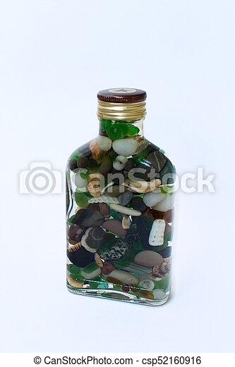 bottle with sea pebbles - csp52160916