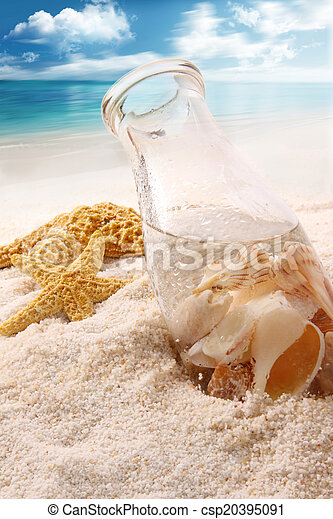 Bottle with shells on the beach - csp20395091