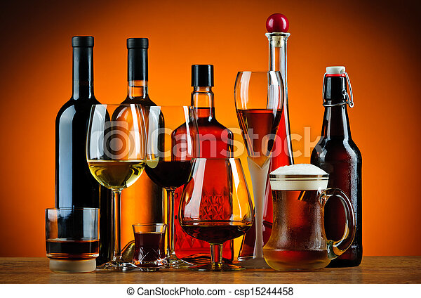Bottles and glasses of alcohol drinks - csp15244458