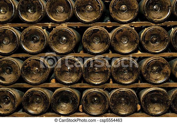 bottles in wine cellar - csp5554463