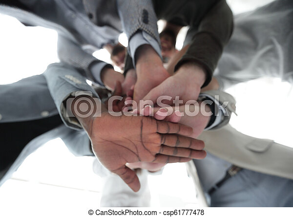 bottom view.business team folded their hands together - csp61777478
