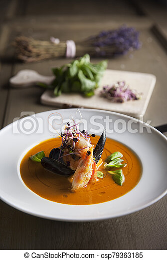 bouillabaisse seafood soup with shrimps salmon and mussels - csp79363185