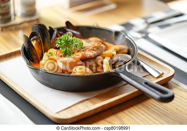 Bouillabaisse with rouille, favourite French seafood soup. - csp80198991